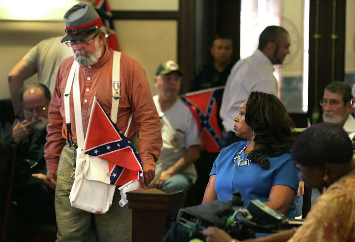 NAACP member Cassandra Littlejohn watches before Bill Manuel of the Sons of Confederate Veterans speaks.