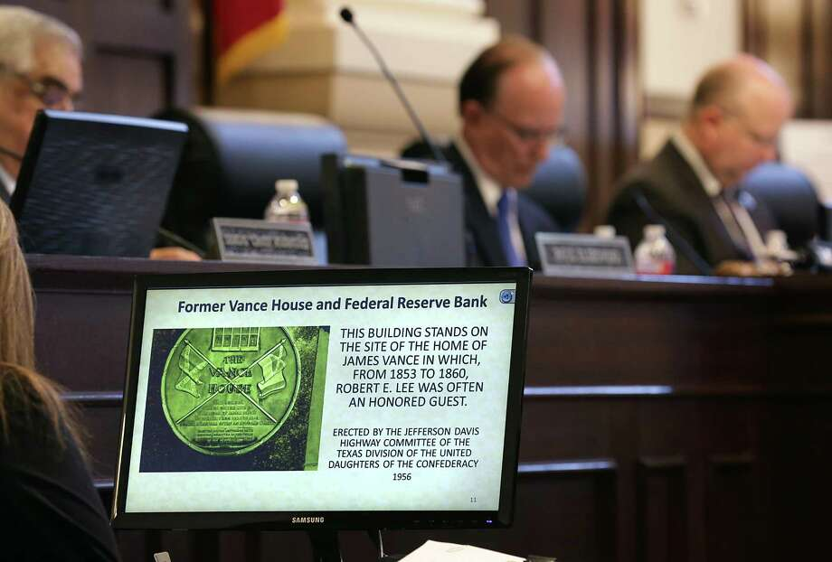 A photo of a historical marker with the Confederate flag is shown in Bexar County Commissioners Court on July 21 as Commissioners were deciding the presence of the flag on markers in Bexar County. It appears the marker will find a new home at the Institute for Texas Cultures. Photo: Bob Owen /San Antonio Express-News / San Antonio Express-News