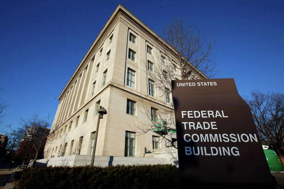 FILE - This Jan. 28, 2015 file photo shows the Federal Trade Commission (FTC) building in Washington. The FTC says identity theft protection company LifeLock is misleading consumers about the level of protection and the timeliness of the warnings they will receive, and charges that LifeLock isn't living up to a previous $12 million settlement with regulators. (AP Photo/Alex Brandon, File) Photo: Alex Brandon, STF / AP