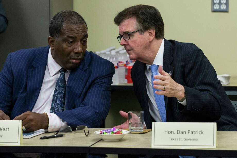 """State Senator Royce West, left, and Lt. Gov. Dan Patrick talk as state and local officials gather for an inquiry looking into the death of Sandra Bland on Tuesday, July 21, 2015, in Houston. Bland, a 28-year-old African American woman, was arrested July 10, after being stopped by a Department of Public Safety trooper for failing to signal a lane change. A DPS spokesman said she was arrested after becoming """"uncooperative"""" and kicking the trooper. Three days later, she was found hanging from a ligature in her cell made from a plastic bag.( Brett Coomer / Houston Chronicle ) Photo: Brett Coomer, Staff / Houston Chronicle / © 2015 Houston Chronicle"""
