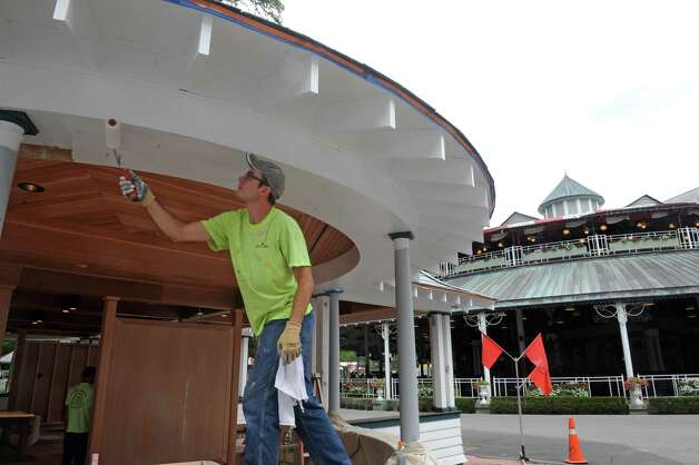 Painter Justin Navarette puts some finishing touches on the new Saratoga Walk of Fame pavilion at Saratoga Race Course on Tuesday July 21, 2015 in Saratoga Springs, N.Y. (Michael P. Farrell/Times Union) Photo: Michael P. Farrell / 00032704A