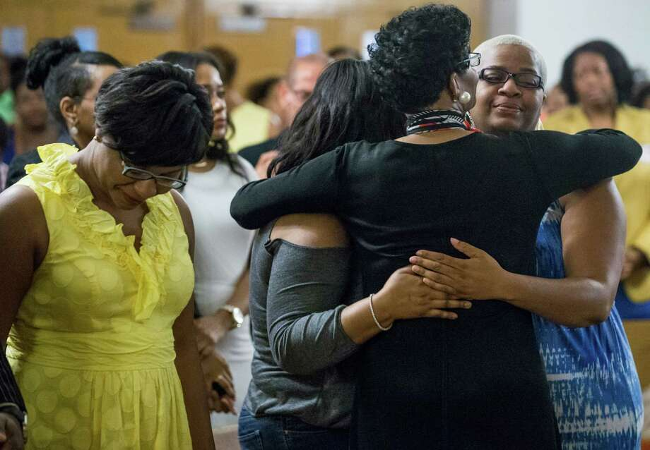 Geneva Reed-Veal, mother of Sandra Bland, embraces her daughter Shante Needham, right, during a memorial service Tuesday at Prairie View A&M. Photo: Brett Coomer, Staff / © 2015 Houston Chronicle