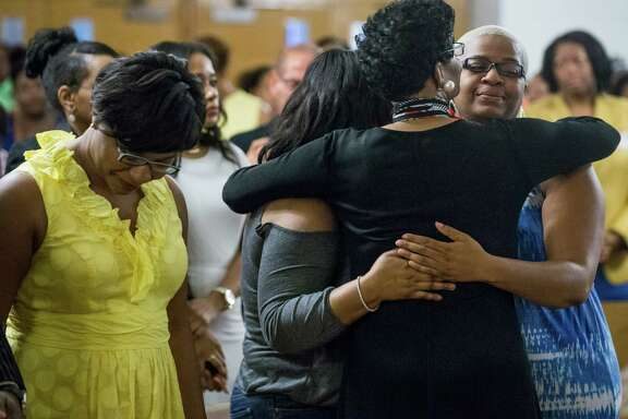 Geneva Reed-Veal, mother of Sandra Bland, embraces her daughter Shante Needham, right, during a memorial service Tuesday at Prairie View A&M.