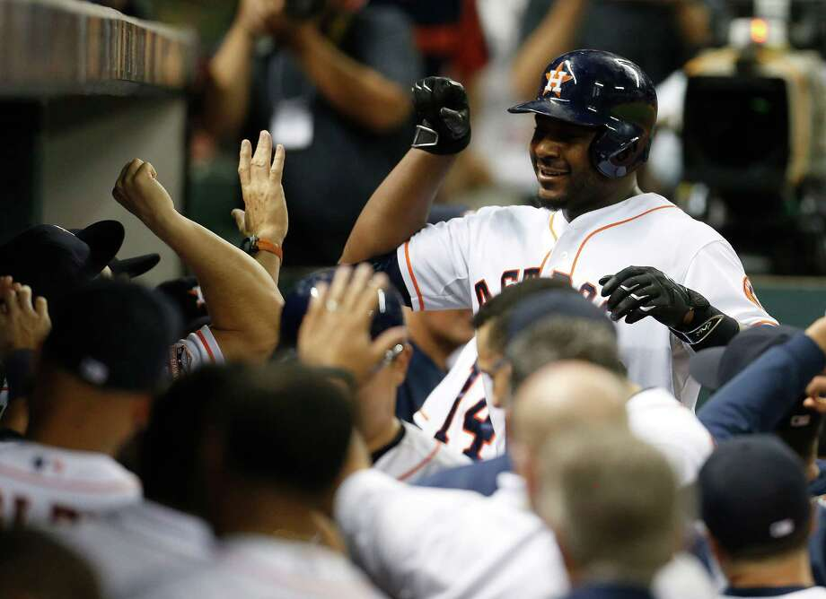 Celebrations like this one have been sporadic for Astros slugger Chris Carter this season. Photo: Karen Warren, Houston Chronicle / © 2015 Houston Chronicle