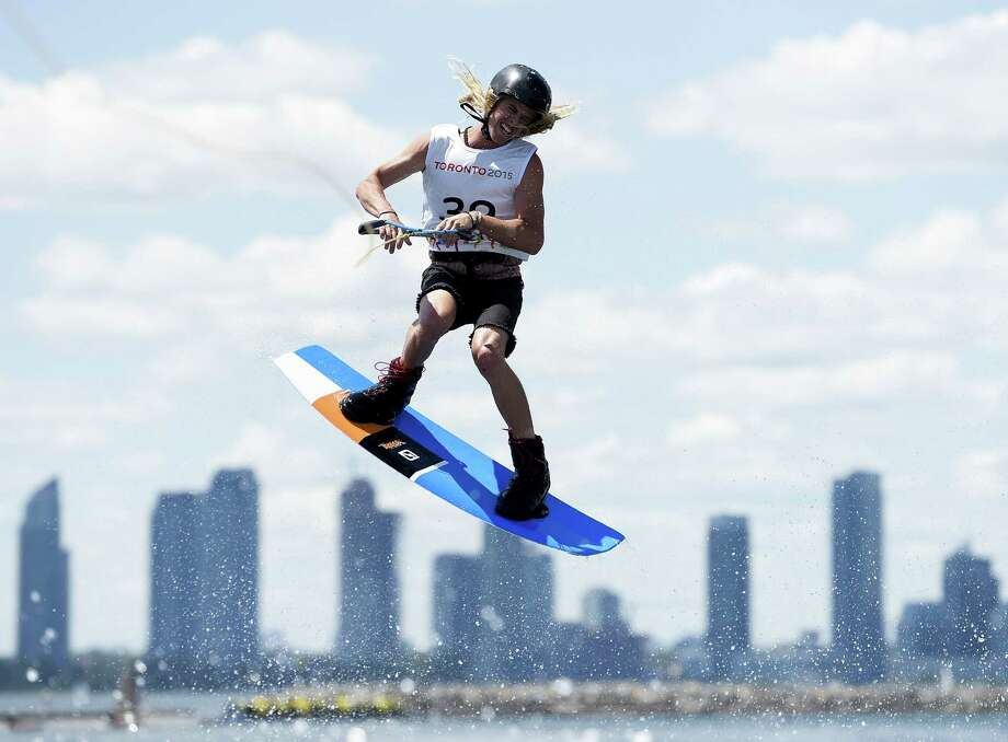 The Toronto skyline provides a picturesque background for Daniel Powers of the United States and other competitors Tuesday in the wakeboarding event on Lake Ontario at the Pan American Games. Wakeboarding will make its Olympic debut on a trial basis at the 2016 Games in Rio de Janeiro. Photo: NATHAN DENETTE, Pool / AFP