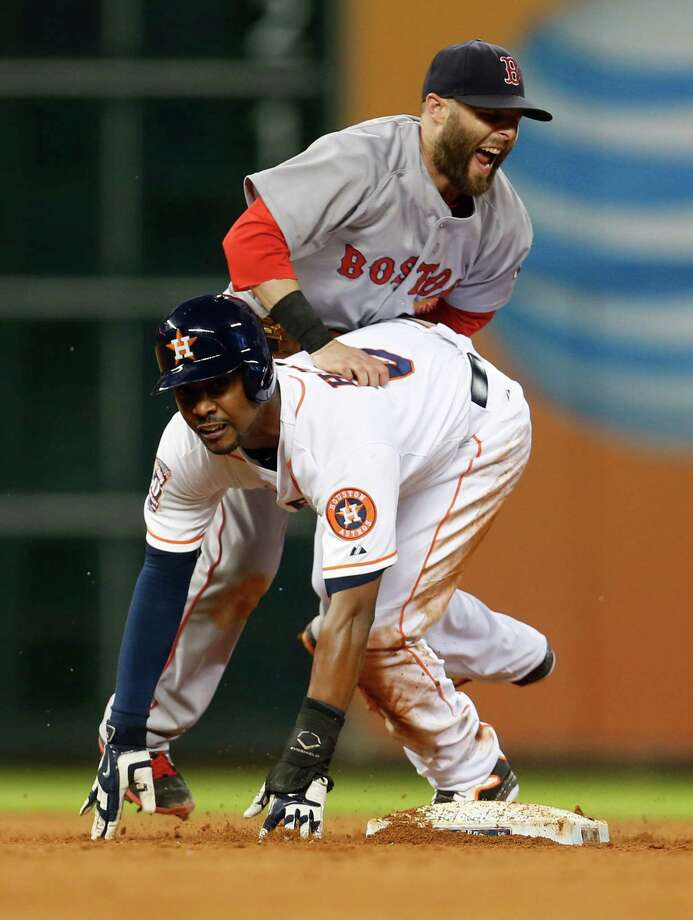 Houston Astros L.J. Hoes (0) runs into Boston Red Sox second baseman Dustin Pedroia (15) at second base as he was tagged out in the fifth inning of an MLB game at Minute Maid Park on Tuesday, July 21, 2015, in Houston. ( Karen Warren / Houston Chronicle ) Photo: Karen Warren, Staff / © 2015 Houston Chronicle