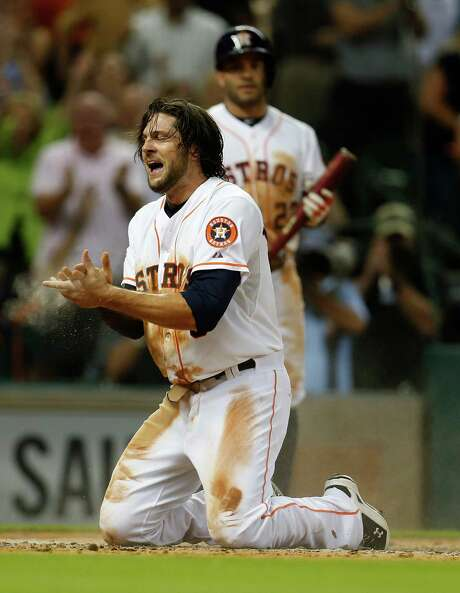 It was a dirty job for Astros center fielder Jake Marisnick to turn an attempted steal of second base into a run in the fifth inning as he took advantage of a throwing error by Red Sox catcher Ryan Hanigan to take a tour of the bases that ended with a headfirst slide. Photo: Karen Warren, Staff / © 2015 Houston Chronicle