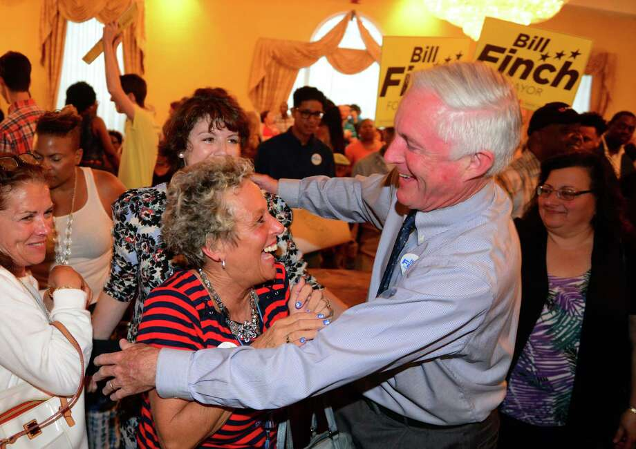 Mayor Bill Finch hugs supporter Kathy Lombard, after he won the Democratic Town Committee endorsement to run for a third term at Testo's Restaurant in Bridgeport on Tuesday. Behind Lombard is Finch's wife, Sonya. Photo: Christian Abraham / Hearst Connecticut Media / Connecticut Post