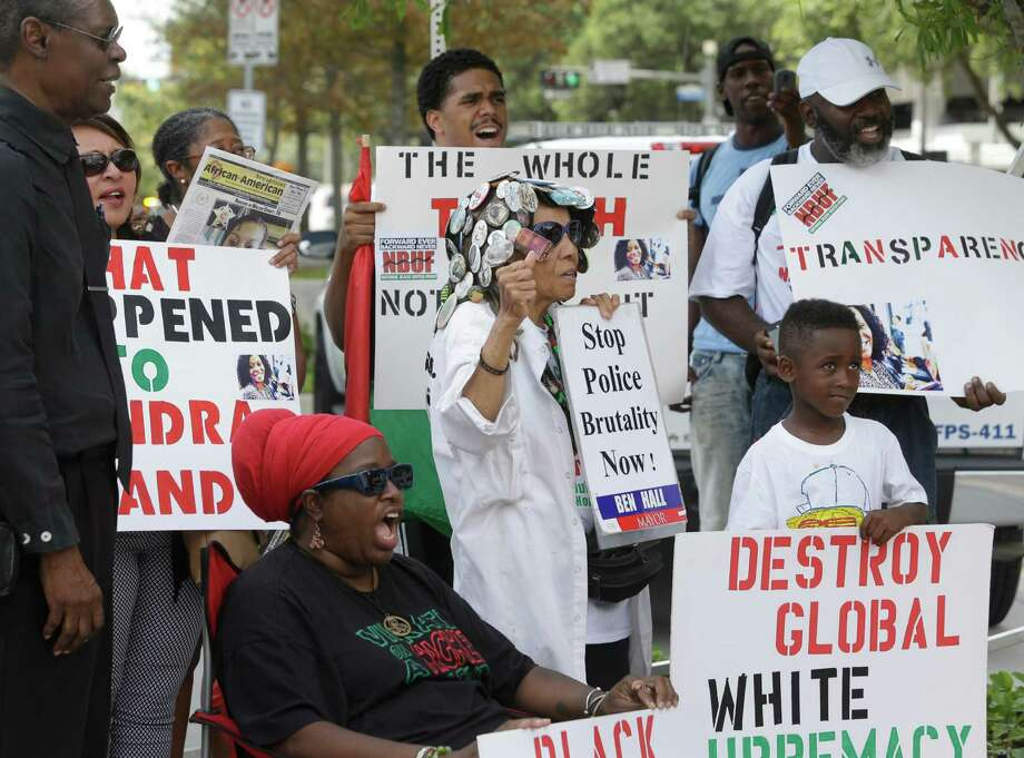 People protest with the National Black United Front outside the Federal Building, 1919 Smith St., about the Sandra Bland case Tuesday, Tuesday, July 21, 2015, in Houston. Bland was found dead in the Waller County Jail three days after she was arrested during a traffic stop. Photo: Melissa Phillip, Houston Chronicle / © 2015  Houston Chronicle
