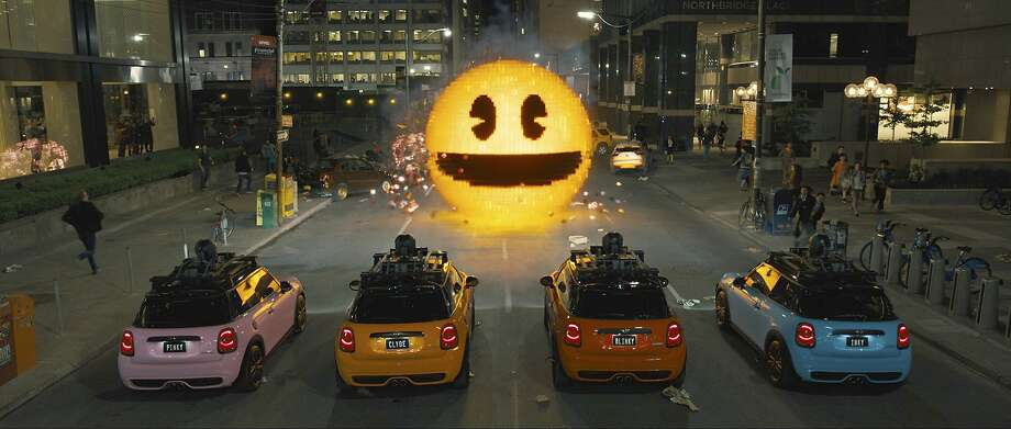 "This photo provided by courtesy of Sony Pictures shows, Inky, Blinky, Clyde and Pinky in Columbia Pictures' ""Pixels."" The movie opens in U.S. theaters on July 24, 2015.  (Sony Pictures via AP) Photo: Courtesy Of Sony Pictures, Associated Press"