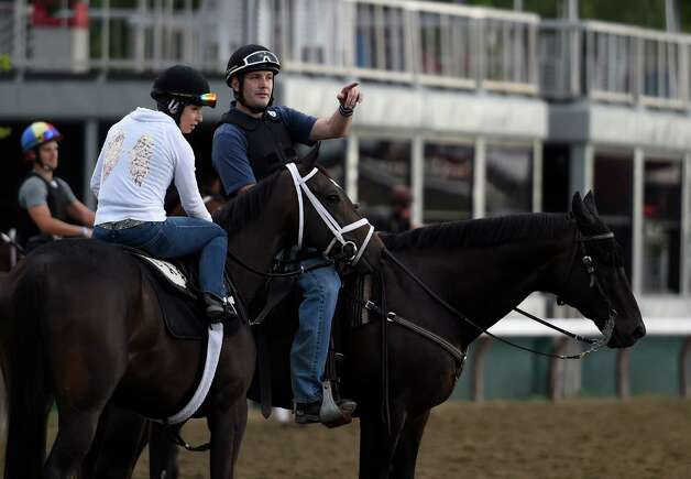 Tristan Berry, assistant to trainer Todd Pletcher, right, speaks with an exercise rider at Saratoga Race Course Wednesday morning, July 22, 2015, with two days before opening day in Saratoga Springs, N.Y. (Skip Dickstein/Times Union) Photo: SKIP DICKSTEIN