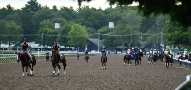 Business is brisk during the morning exercise period at Saratoga Race Course Wednesday morning July 22, 2015, with two days before opening day in Saratoga Springs, N.Y. (Skip Dickstein/Times Union) Photo: SKIP DICKSTEIN