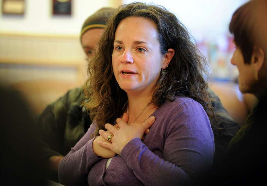 Michele Bialek, owner of Liquid Lunch, expresses her gratitude over the outpouring of community support following Monday's fire on Howe Ave. during a press conference at the Echo Hose Fire Station in Shelton, Conn. Tuesday, Jan. 7, 2013. Photo: Autumn Driscoll / Autumn Driscoll / Connecticut Post