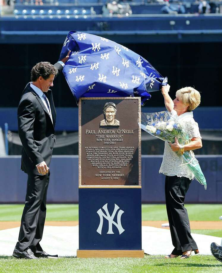 NEW YORK, NY - AUGUST 09:  Former New York Yankee Paul O'Neill and his wife Nevalee unveil his Yankee Stadium monument park plaque before a game against the Cleveland Indians on August 9, 2014 in the Bronx borough of New York City.  (Photo by Jim McIsaac/Getty Images) Photo: Jim McIsaac / Getty Images / 2014 Getty Images