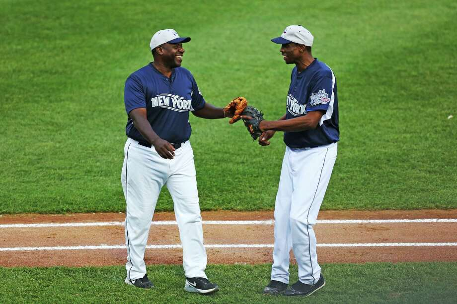 Former Yankees Dwight Gooden and Charlie Hayes share a laugh during the end of second inning play at Thursday evening Legends game vs former Red Sox at Harbor Yard in Bridgeport on July 9, 2015. Photo: Mike Ross / For Hearst Connecticut Media / Connecticut Post Freelance
