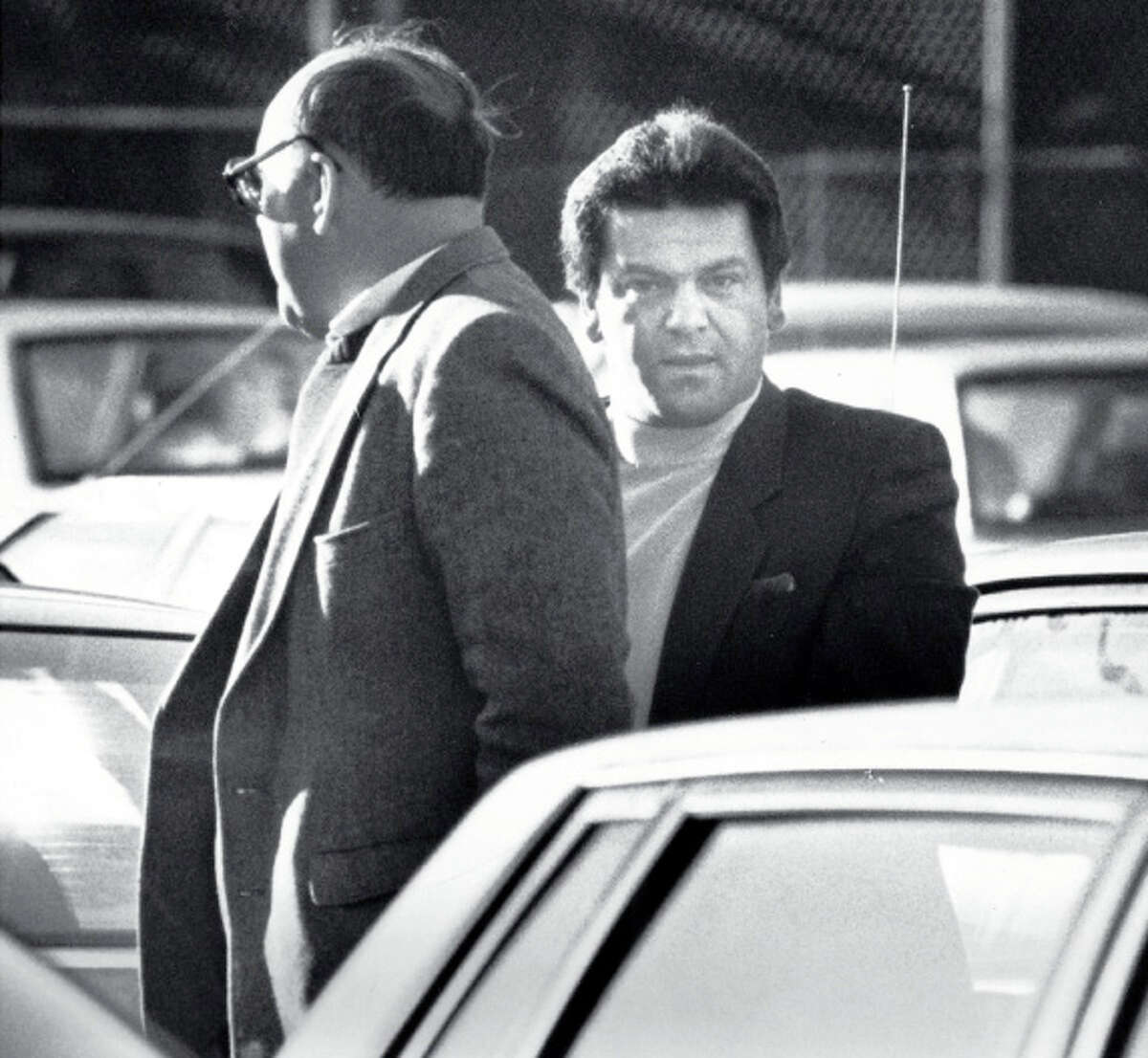 Anthony Megale, right, is taken to U.S. District Court in Bridgeport in December, 1989 for a bond hearing.