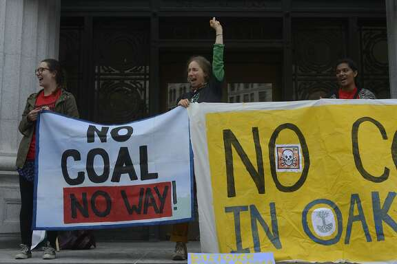 Protesters gather outside of Oakland City Hall to argue against the building of a coal-export facility at the old Oakland Army Base in Oakland, California, on Tuesday, July 21, 2015.