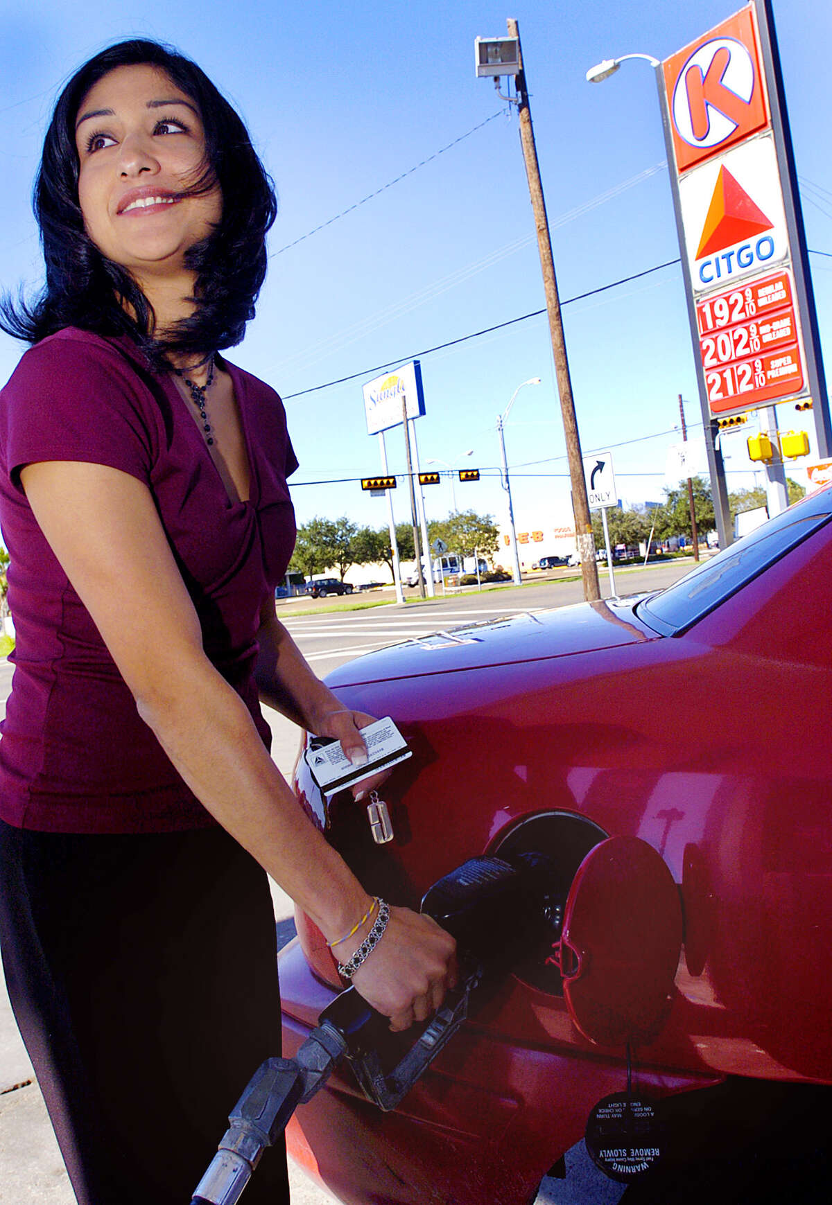 Erika Garcia fills up Tuesday. Nov. 1, 2005. at the Circle K on Monroe Avenue and Austin Street in Harlingen, Texas. where gas was selling for $1.92 a gallon.