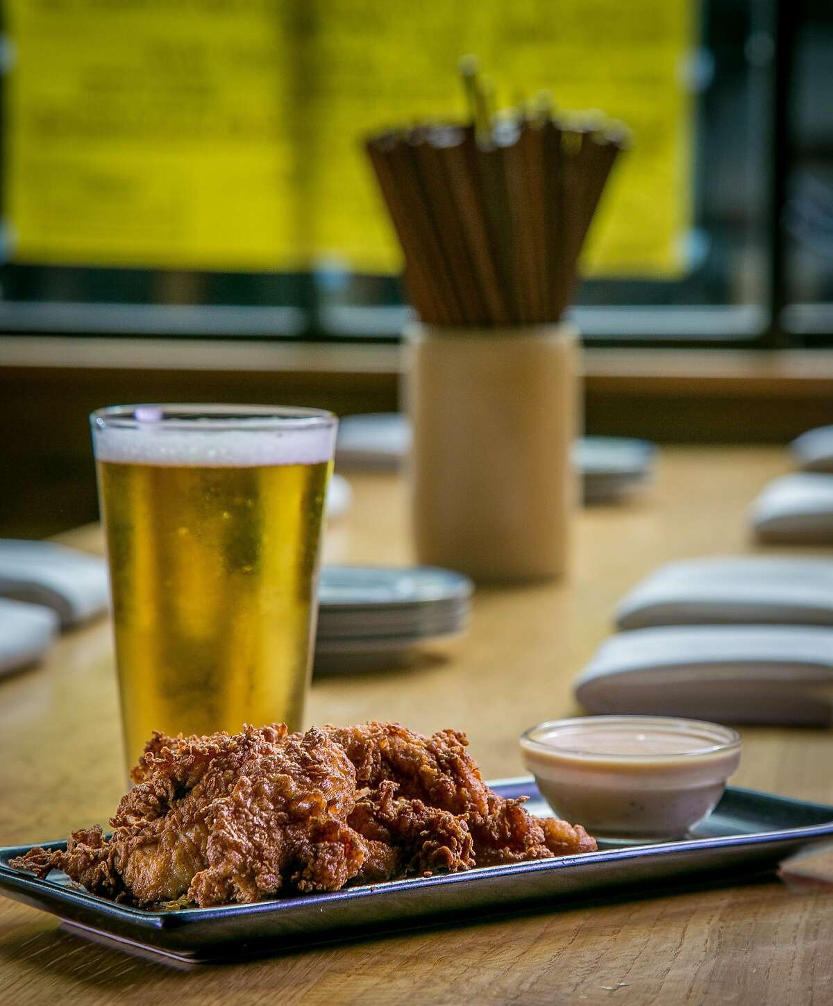 The Chubby Fried Chicken with a beer at Chubby Noodle in San Francisco, Calif., is seen on July 21st, 2015.
