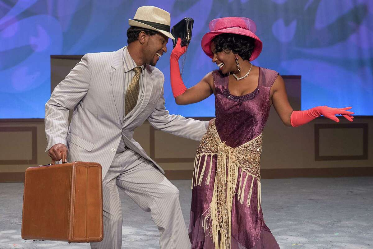 """End Zone Live! At the Ensemble Theatre(Monday, Jan. 30)The theater will host two showings of a special variety show in celebration of the Super Bowl. Expect comedy, music and dance from the Ensemble cast. Tickets are free but limited. Andre' Neal and Aisha Ussery perform in the Ensemble Theatre's production of """"Trav'lin."""""""