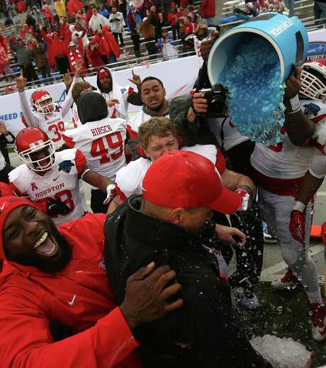 Interim head coach David Gibbs of the Houston Cougars celebrates after defeating the Pittsburgh Panthers during the Lockheed Martin Armed Forces Bowl game at Amon G. Carter Stadium on January 2, 2015, in Fort Worth. Photo: Sarah Glenn / 2015 Getty Images