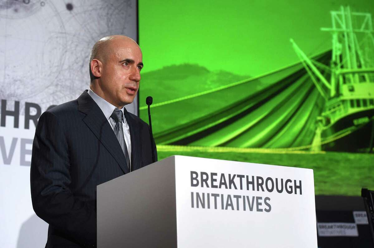 LONDON, ENGLAND - JULY 20: (L-R) DST Global Founder Yuri Milner speaks as he attends a press conference on the Breakthrough Life in the Universe Initiatives, hosted by Yuri Milner and Stephen Hawking, at The Royal Society on July 20, 2015 in London, England. (Photo by Stuart C. Wilson/Getty Images for Breakthrough Initiatives)