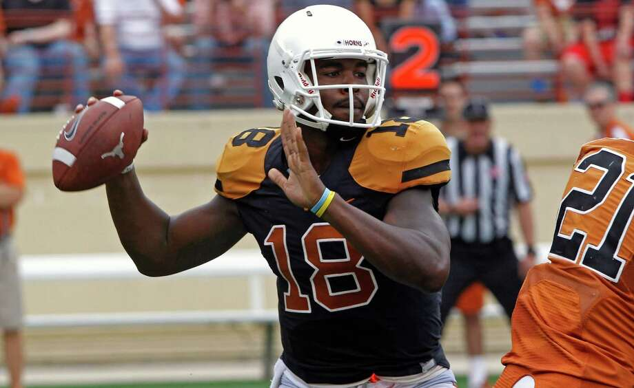 Texas quarterback Tyrone Swoopes (18) looks to throw during the first quarter of Texas' Orange and White spring NCAA college football game, Saturday, April 18, 2015, in Austin, Texas. Photo: Michael Thomas /Associated Press / FR65778 AP