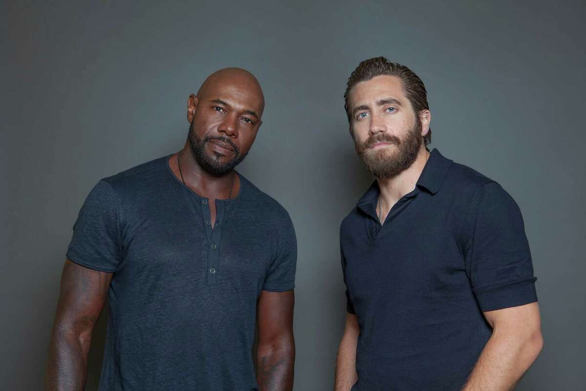 In this Sunday, July 12, 2015 photo, Antoine Fuqua, left, and Jake Gyllenhaal, pose for a portrait in promotion of their new film