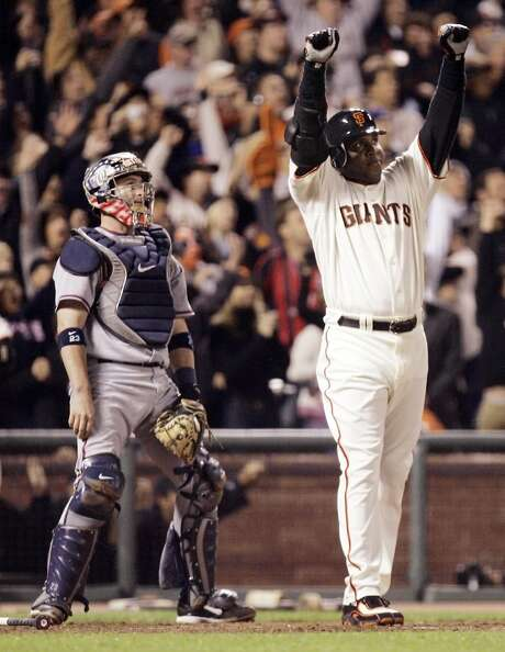 FILE - In this Tuesday, Aug. 7, 2007, file photo, San Francisco Giants Barry Bonds celebrates after his 756th career home run in the fifth inning of a baseball game against the Washington Nationals in San Francisco. The U.S. Department of Justice formally dropped its criminal prosecution of Barry Bonds, Major League Baseball's career home run leader. The decade-long investigation and prosecution of Bonds for obstruction of justice ended quietly Tuesday morning, July 21, 2015, when the DOJ said it would not challenge the reversal of his felony conviction to the U.S. Supreme Court.  (AP Photo/Eric Risberg, File) Photo: Eric Risberg, Associated Press