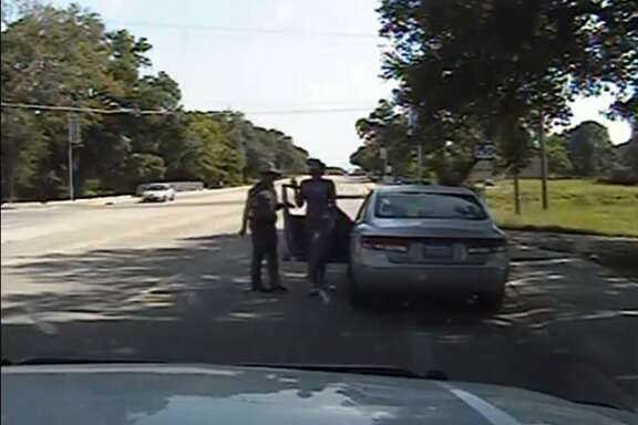 "This screen grab taken from video footage from the arresting officer's dashcam, released by the Texas Department of Public Safety on July 22, 2015, shows Texas state trooper Brian Encinia (centre L) next to the car as 28-year-old Sandra Bland (centre R) gets out of her vehicle following a stop for allegedly failing to signal a lane change, in Waller County, Texas on July 10, 2015.  Texan authorities released footage on July 21, 2015 showing the white police officer, during a routine traffic stop, argue with and arrest the unarmed black woman who later died in jail. The death of 28-year-old Sandra Bland is being investigated as possible suspicious, after authorities initially called her death on July 13 in Waller County jail an apparent suicide.       AFP PHOTO / TEXAS DEPARTMENT OF PUBLIC SAFETY ----EDITORS NOTE ----RESTRICTED TO EDITORIAL USE MANDATORY CREDIT ""AFP PHOTO / TEXAS DEPARTMENT OF PUBLIC SAFETY"" NO MARKETING  - NO ADVERTISING CAMPAIGNS - DISTRIBUTED AS A SERVICE TO CLIENTS - NO ARCHIVESTEXAS DEP. OF PUBLIC SAFETY/AFP/Getty Images"