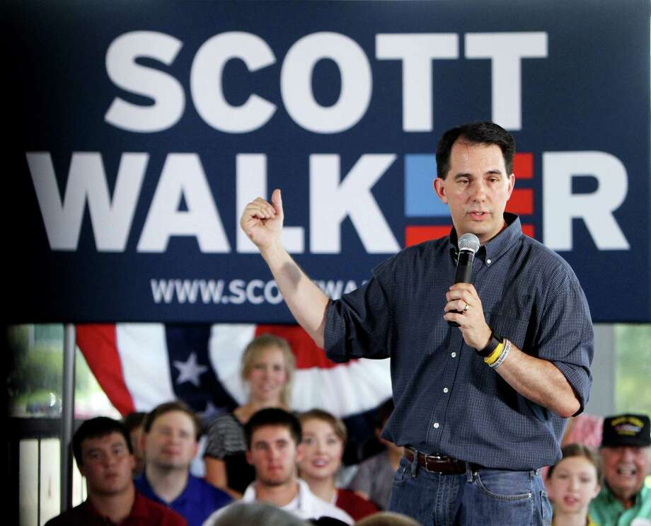 Presidential candidate Wisconsin Gov. Scott Walker speaks to a room of supporters at Modern Woodman Park in Davenport, Iowa, Friday, July 17, 2015. (Kevin E. Schmidt/The Quad City Times via AP) Photo: Kevin E. Schmidt / Associated Press / The Quad City Times