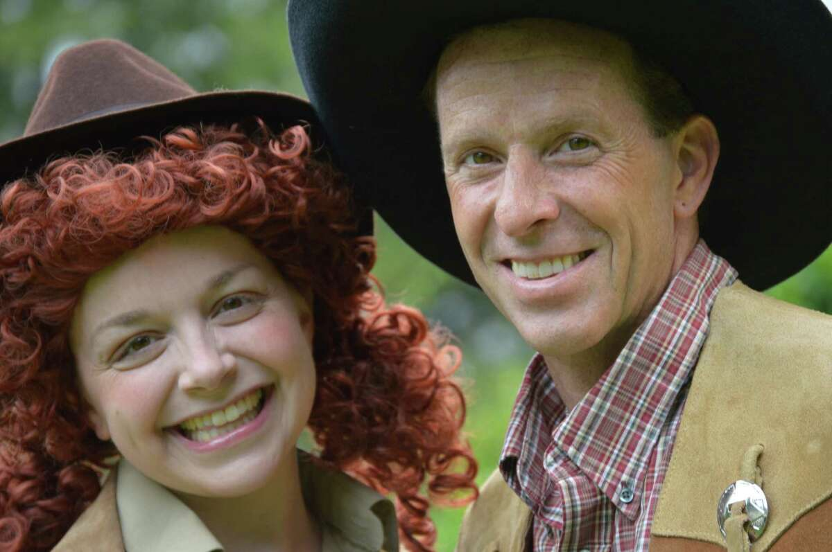 L. Nagle, of Torrington, takes aim playing the role of legendary sharpshooter Annie Oakley and Robert Bria, of Redding, is her Wild West Show rival and love interest, Frank Butler, in
