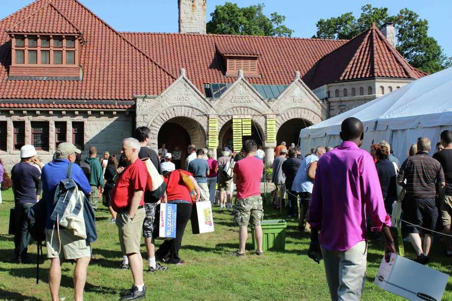 Patrons mill about waiting for the opening of the 2014 Pequot Library book sale, which this year runs July 24-28. Photo: Contributed Photo