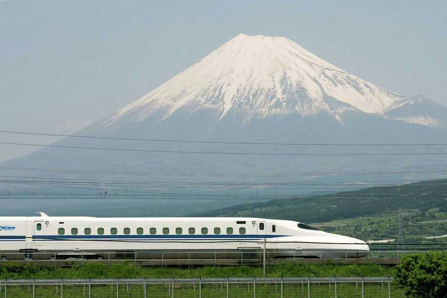 The Japanese N700 Series Shinkansen train, shown here passing Mt. Fuji, will be used along the Houston-to-Dallas line. Photo: Texas Central Partners