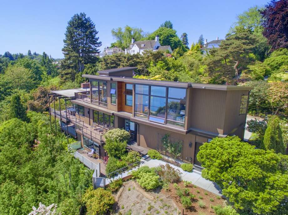 This home,3701 E. Valley St., is listed for$4.786 million. The four bedroom, four bathroom home features views of Mt. Rainier, the Cascade Mountains, the city lights of Bellevue and the shores of Lake Washington.You can see the full listing here. Photo: Courtesy Of Kelly Cash