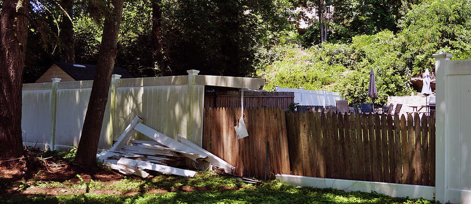 A motorist lost control of his car Tuesday afternoon, crashing through the fence at a Wilson Street home. Photo: Genevieve Reilly / Fairfield Citizen / Fairfield Citizen