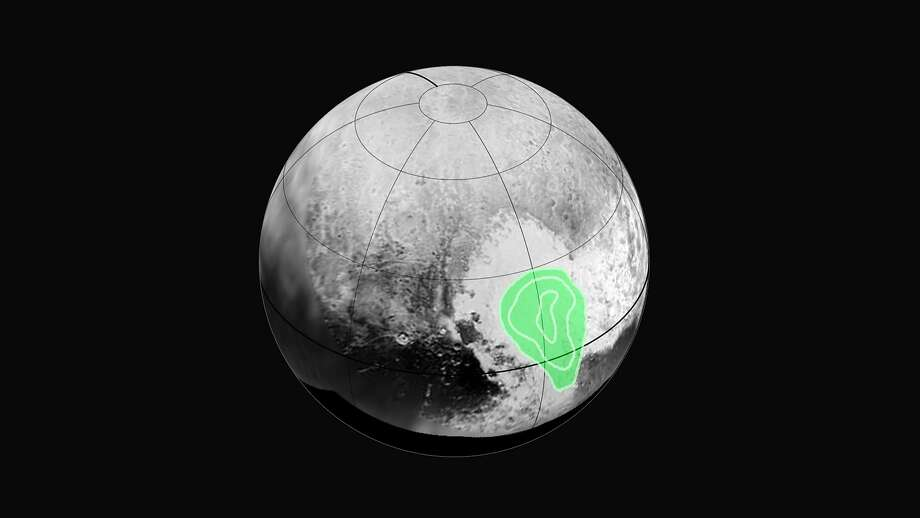 "The New Horizons probe revealed evidence of carbon monoxide ice on Pluto. The concentration appears to increase towards the center of the ""bull's eye."" Photo: Nasa, McClatchy-Tribune News Service"