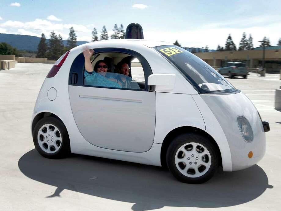 Teresa Favuzzi of Sacramento takes a ride in the Google self-driving prototype car in Mountain View, Calif. , this spring. Photo: Tony Avelar /Associated Press / FR155217 AP