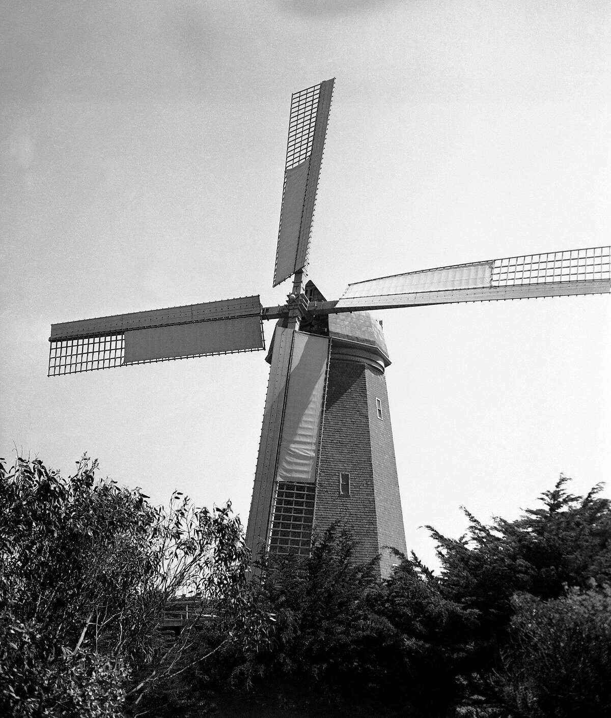 In this May 30, 1936 file photo, the historic landmark Murphy Windmill stands in Golden Gate Park in San Francisco. The windmill's 68-ton copper dome was placed back on top of the structure on Monday, Sept. 12, 2011, after undergoing nearly a decade of restoration.