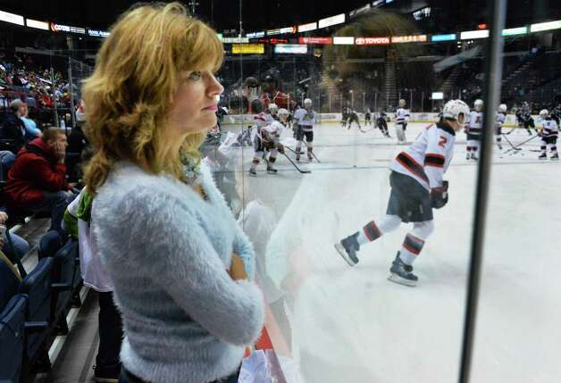Veteran Albany Devils fans Jeanne Carras of Troy watches her team warm up before Saturday's game against the Manchester Monarchs at the Times Union Center Jan. 11, 2014, in Albany, NY.  (John Carl D'Annibale / Times Union) Photo: John Carl D'Annibale / 00025290A