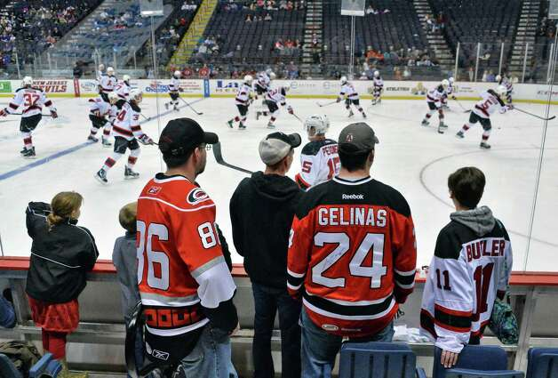 Albany Devils fans watch their team warm up before Saturday's game against the Manchester Monarchs at the Times Union Center Jan. 11, 2014, in Albany, NY.  (John Carl D'Annibale / Times Union) Photo: John Carl D'Annibale / 00025290A