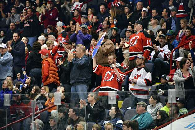 Albany Devils'  fans cheer during the second game of a best-of-5 American Hockey League playoff series against the  St. John's IceCaps at the Times Union Center Saturday April 26, 2014, in Albany, NY. ( John Carl D'Annibale / Times Union) Photo: John Carl D'Annibale / 00026569A
