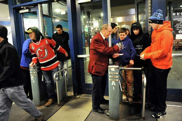 Hockey fans get their tickets scanned as they enter for the IceCaps vs. Devils game on Friday, Jan. 30, 2015, at Times Union Center in Albany, N.Y. (Cindy Schultz / Times Union) Photo: Cindy Schultz / 00030363A