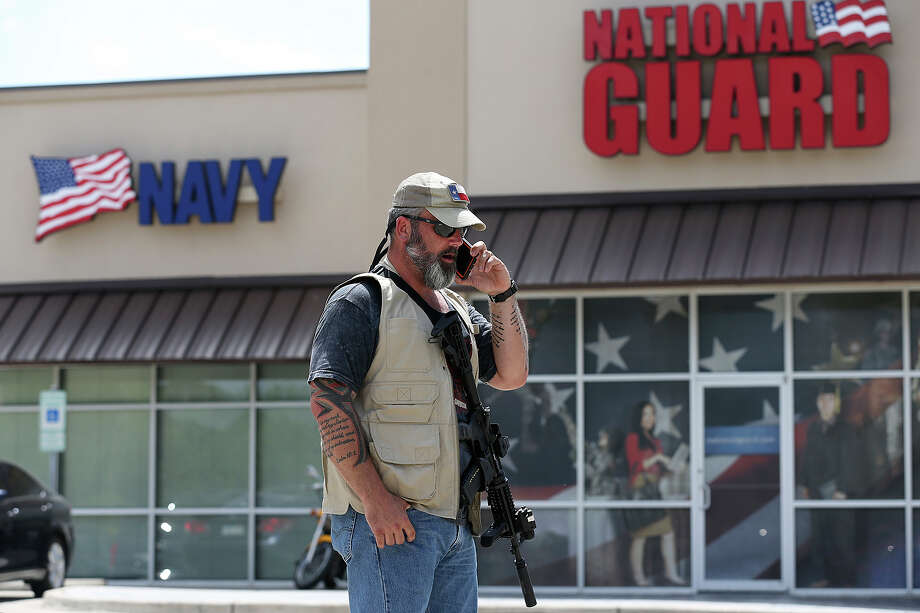 Allen Weaver stands guard with a group of armed citizens outside the Armed Forces Career Center in McAllen, Texas, Wednesday, July 22, 2015. The group, who described themselves as American Patriots, have been guarding the military recruiting centers in reaction to the shootings in Chattanooga, Tennessee shootings that left four U.S. Marines and one Navy sailor dead. Photo: JERRY LARA, Staff / San Antonio Express-News / © 2015 San Antonio Express-News