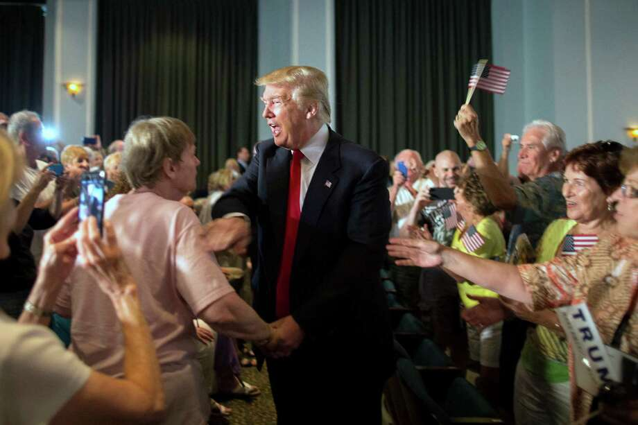 Republican presidential hopeful Donald Trump greets supporters at a South Carolina campaign rally in Bluffton on Tuesday. His speak-first-and-think-later style is keeps us watching his every move. Photo: Stephen B. Morton /Associated Press / FR56856 AP