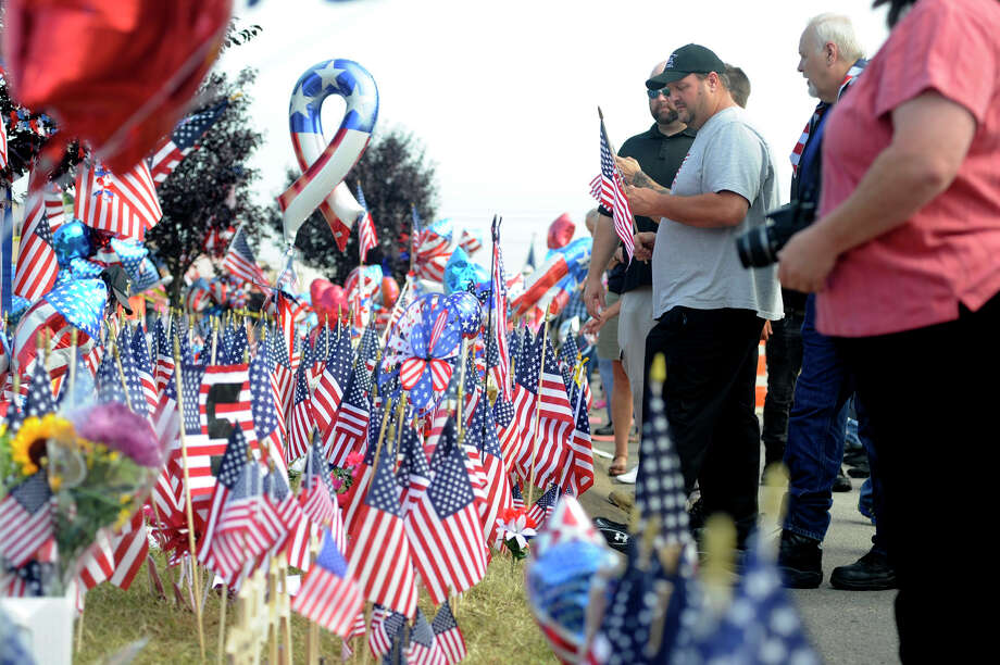 Four days after it was targeted in shootings that left five people dead, people gather at a military recruiting office in Chattanooga, Tenn. A reader says the murders — along with recent events — illustrate the lack of leadership in America. Photo: Jay Reeves /Associated Press / AP