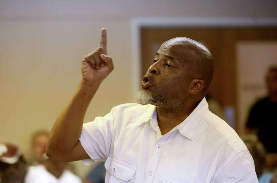Dewayne Charleston, of Prairie View, former Waller County justice of the peace, asking county commissioners for the resignation of Waller County Sheriff Glenn Smith in a Waller County meeting of Commissioners Court at the courthouse Wednesday, July 22, 2015, in Hempstead, Texas. Sandra Bland, 28, was found dead in her cell at the Waller County Jail days after she was detained by police during a routine traffic stop. ( Gary Coronado / Houston Chronicle ) Photo: Gary Coronado, Staff / Houston Chronicle / © 2015 Houston Chronicle