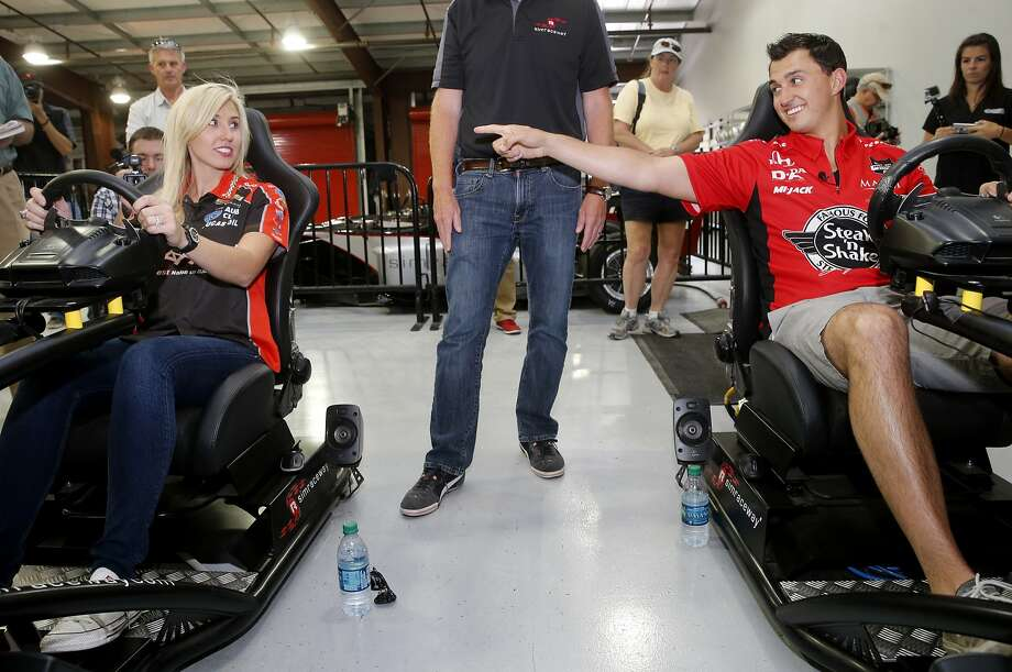Courtney Force and her fiancee Graham Rahal prepared to do battle at the Simraceway Driving Center at Sonoma Raceway. Courtney Force, who is NHRA's winningest female driver, defeated her IndyCar fiancee Graham Rahal in a racing skills challenge at Sonoma Raceway Wednesday July 22, 2015. Photo: Brant Ward, The Chronicle