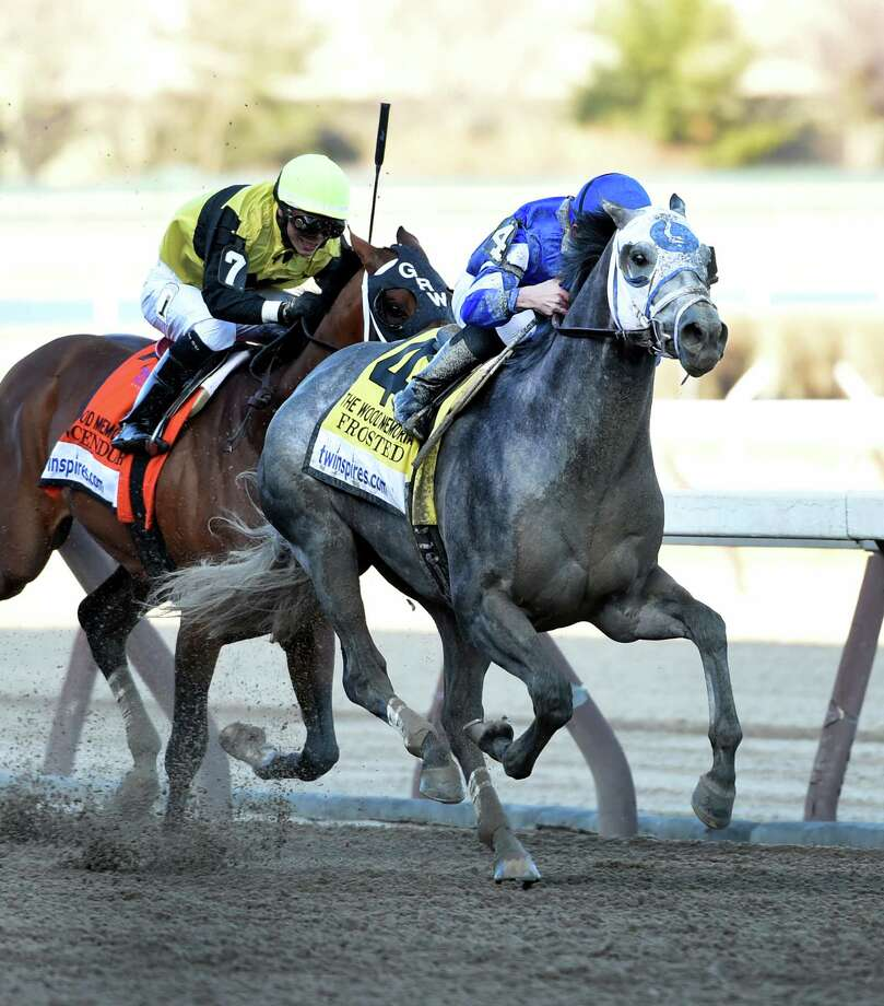 #4 Frosted with jockey Joel Rosario in the saddle moves past #7 Tencendur with jockey Jose Ortiz to win the 91st running of The Wood Memorial Saturday April 4, 2015 at Aqueduct Race Track in Ozone Park, N.Y.        (Skip Dickstein/Times Union) Photo: SKIP DICKSTEIN