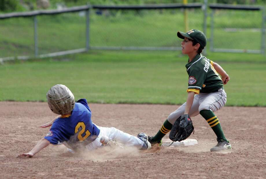 Newtown's Jackson Khan beats the throw to New Milford's Jack Coloneri on a second base steal in the first inning during the Ripken Baseball State Championship game at Glander Sports Complex in Newtown, Conn. on Tuesday, July 21, 2015. The game was  suspended for weather in the bottom of the second inning with New Milford leading 3-1 over Newtown. Photo: Matthew Brown / For Hearst Connecticut Media / Connecticut Post Freelance